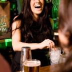Bartender enjoying her job.